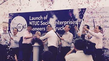 NTUC Social Enterprises combine muscle to reach out to pioneers and the elderly with the launch of a special truck and a new SilverACE Senior Activity Centre.