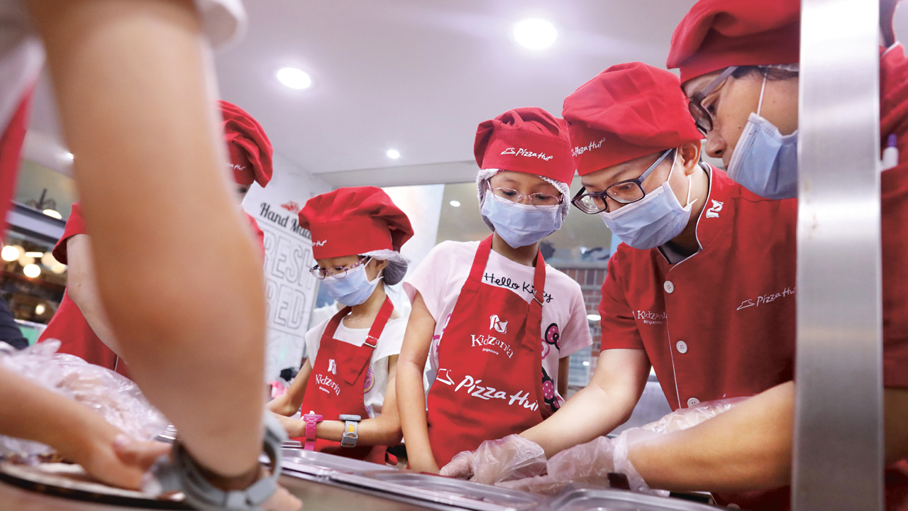 At KidZania's Pizza Hut, Zupervisors guide the young ones, while ensuring cleanliness and safety in the kitchen