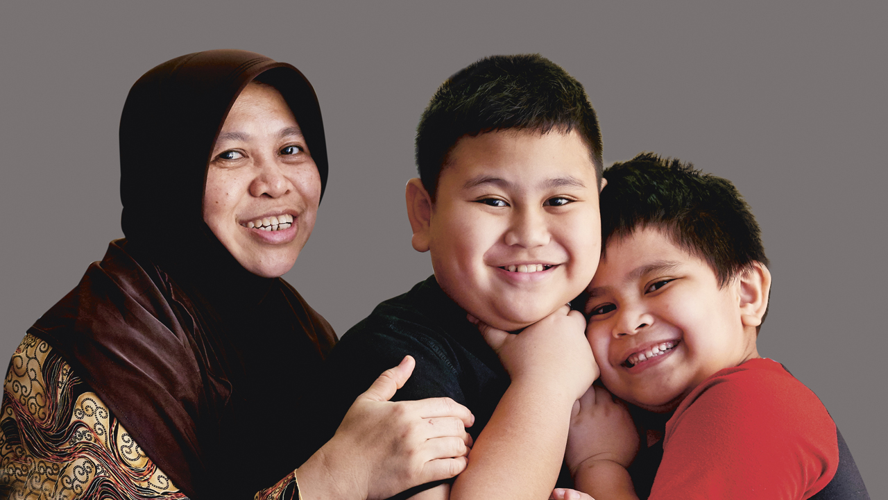 With help from NTUC U Care Assistance Programmes, Madam Nisa was able to ease some of the costs of her two schoolgoing children's education, and ensuring that they benefit from the same opportunities as others. (Photo Source: NTUC This Week)