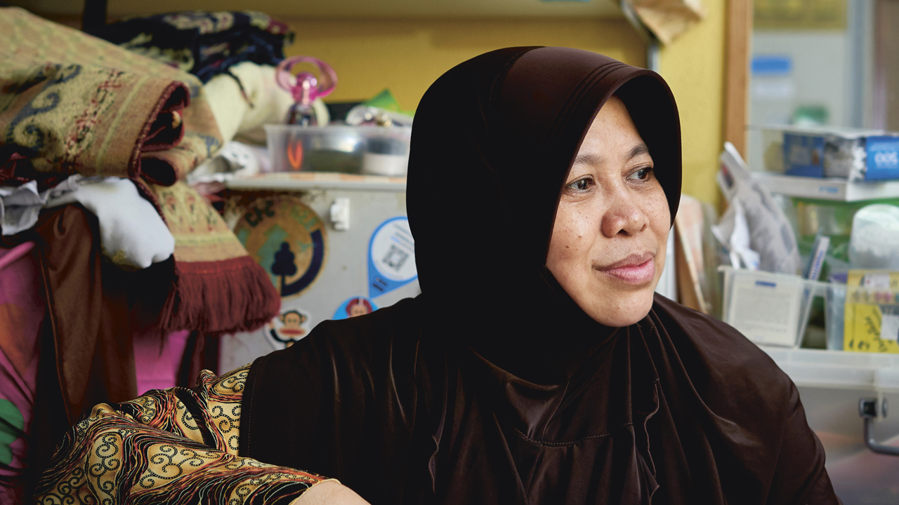 After her husband became bedridden, 46-year-old Madam Nisa Uswatan had to return to the workforce so as to provide for her young family. (Photo Source: NTUC This Week)