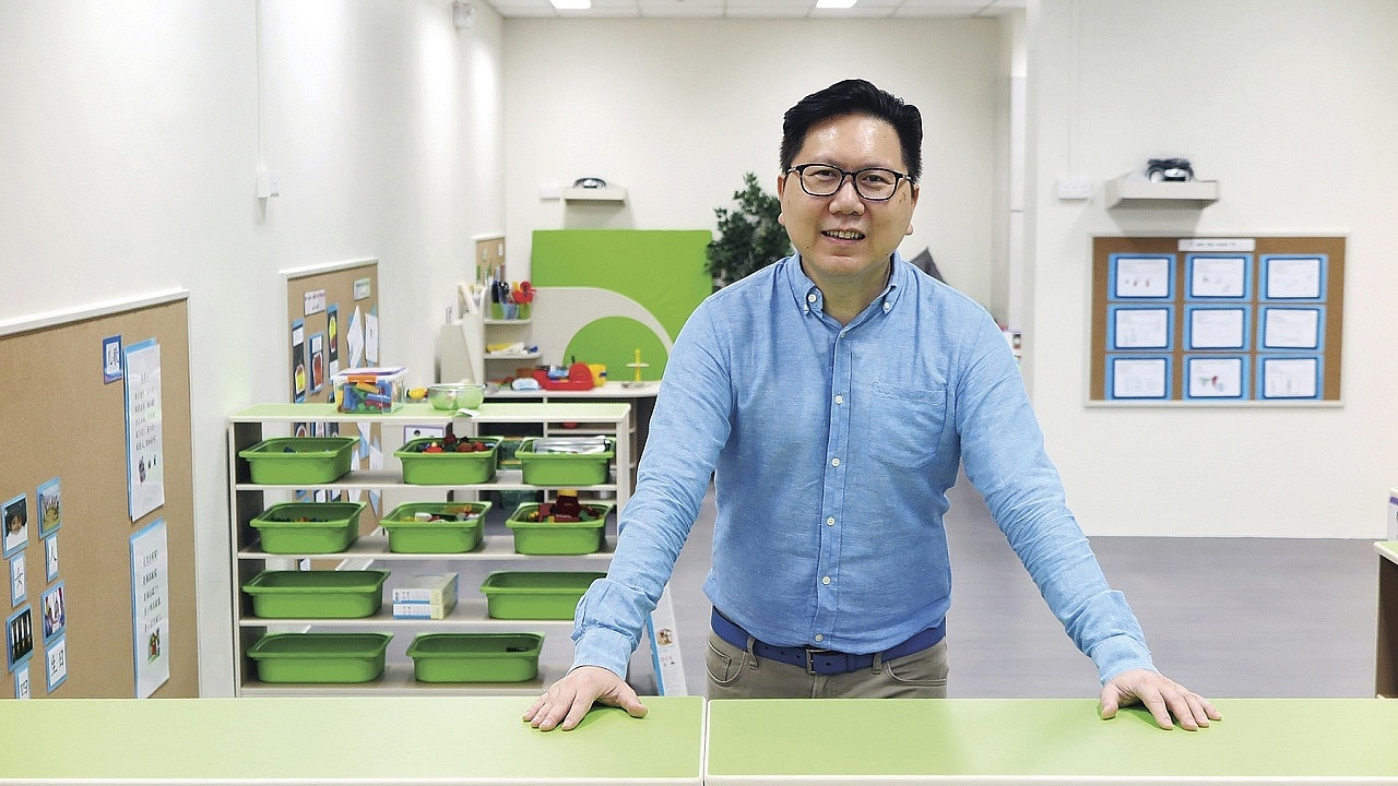 After 12 years in the IT sector, 52-year-old Wayne Lin decided to make the bold move into the preschool environment, through the Professional Conversion Programme. Photo Source: NTUC This Week)