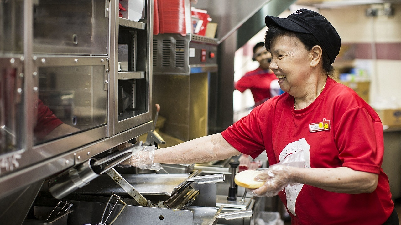 Having been on the job for 30 years, 71-year-old Lee Kwai Fong has become an expert at preparing KFC food items.