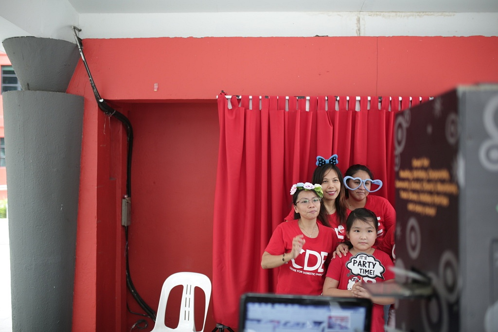 With a photo booth on-site with quirky props available for use, our domestic employees got creative and posed for a fun family photo! Domestic employees were are also encouraged to invite their employers along to the event and celebrate May Day together