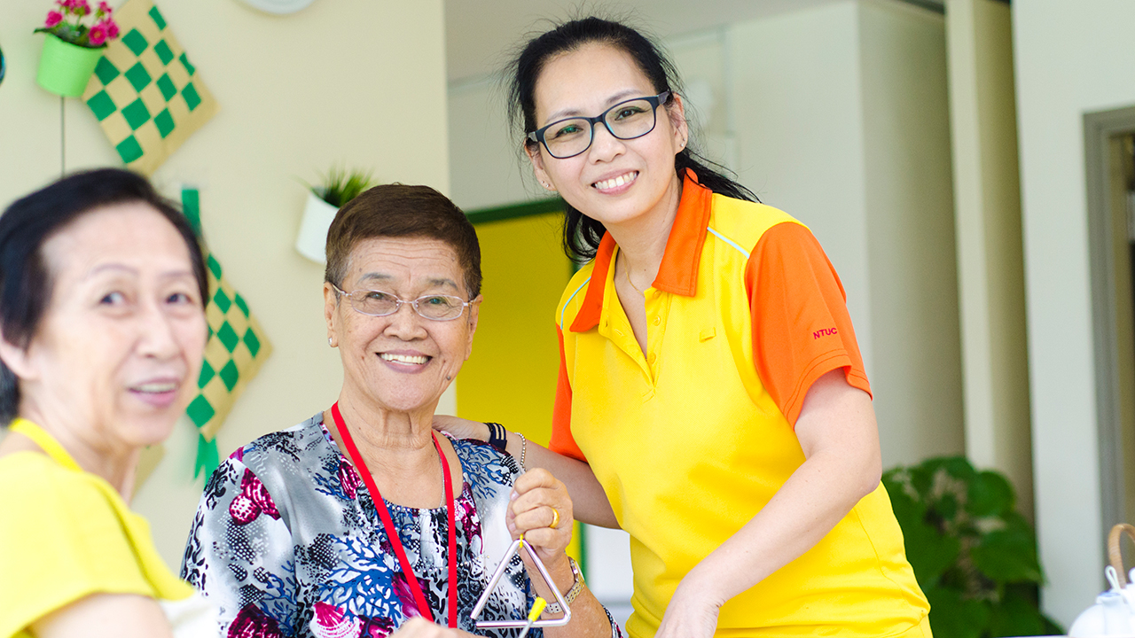 """""""I want to set a positive example to my children that we must always embrace learning and improve ourselves,"""" says NTUC Health Silver Circle Dementia Care Coordinator Sharon Kwek.(Photo Source: NTUC This Week)"""