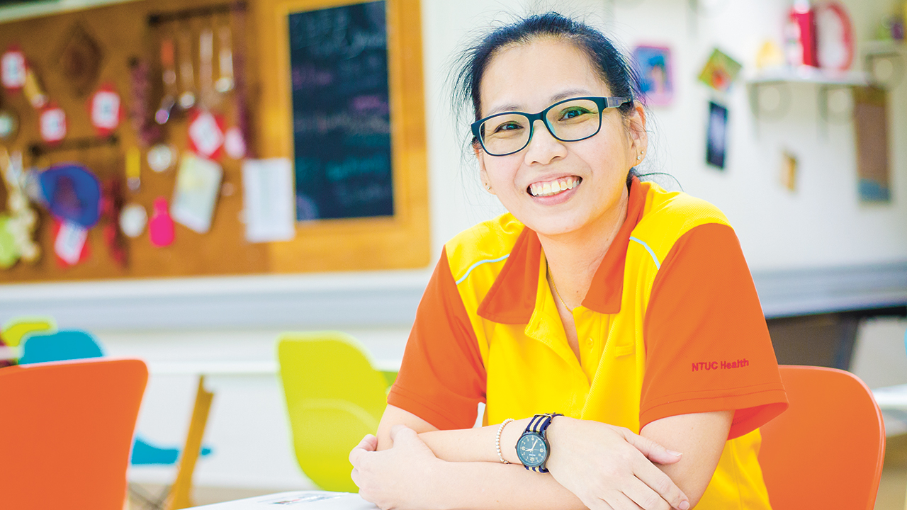 After two months of serious consideration, Sharon took a leap of faith and a 50 per cent pay cut to join the healthcare industry as a therapy assistant with NTUC Health's Silver Circle. (Photo Source: NTUC This Week)