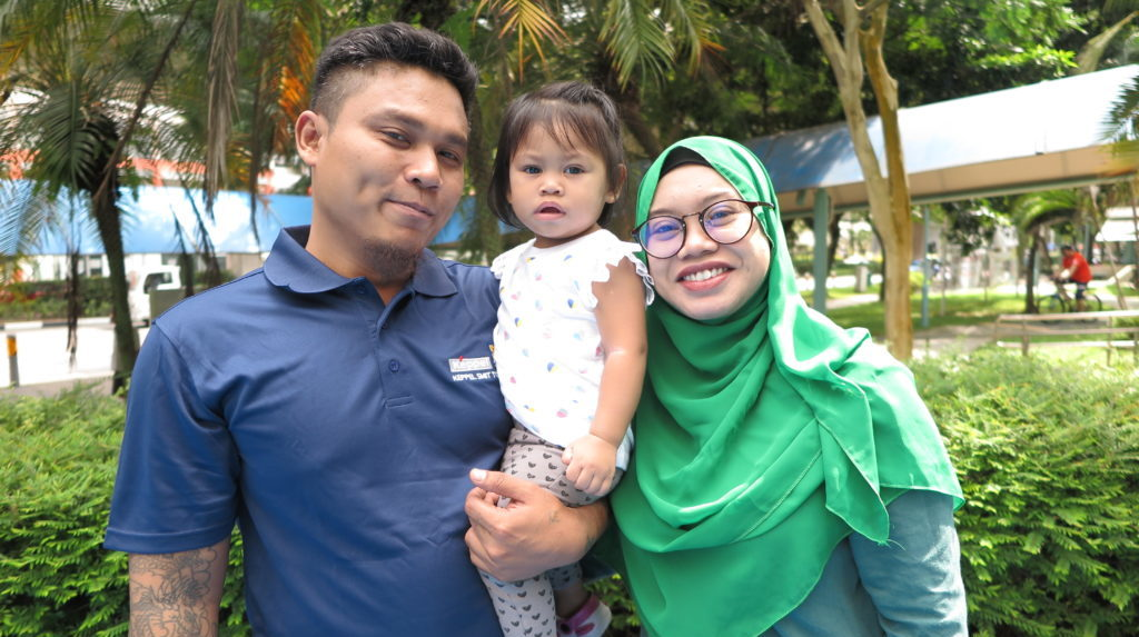 Mohammed Sha Rizan, on a day out with his wife and young daughter.