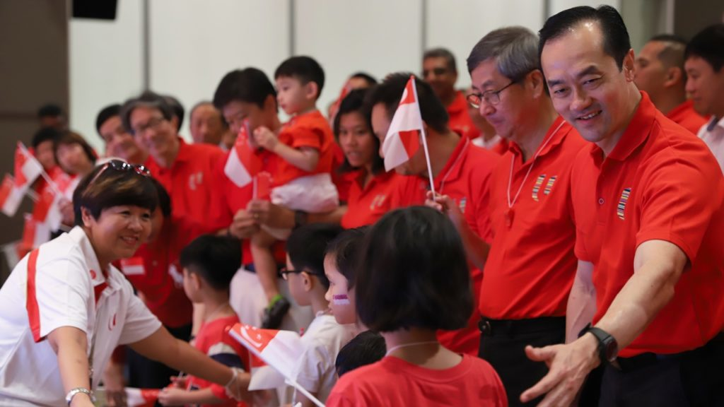 NTUC Deputy Secretary-General Koh Poh Koon welcomes the children to the front of the stage.
