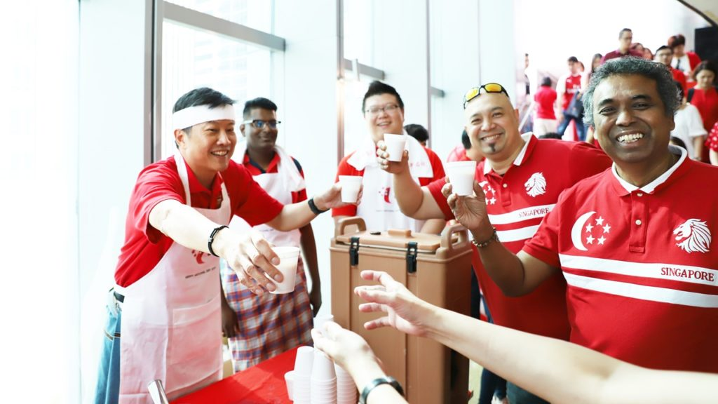 Union leaders toast with cups of Teh Tarik – specially prepared by SG Ng.