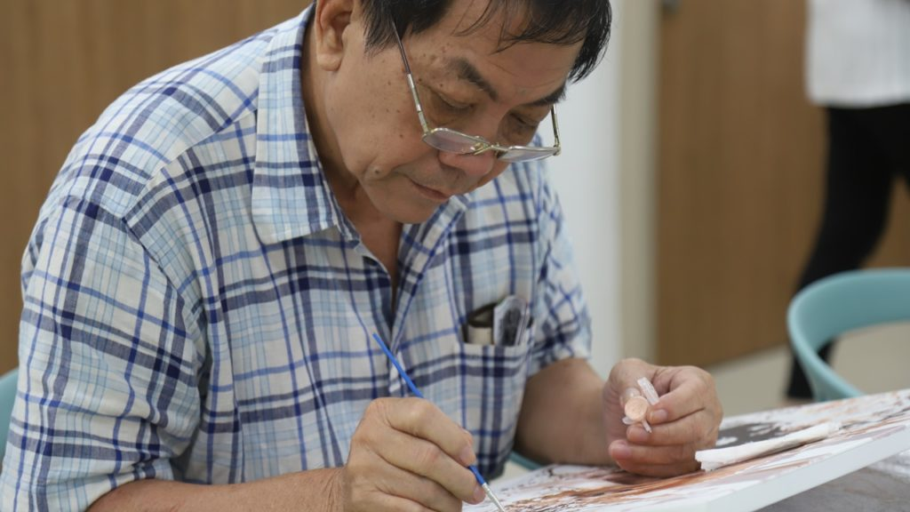 Painting is one of the activities Mr Poo enjoys doing in at the Active Ageing Hub.