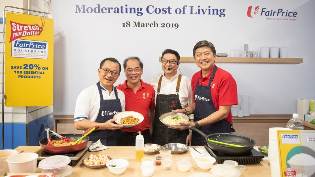 From left: FairPrice CEO Seah Kian Peng, NTUC Enterprise Executive Director Kee Teck Koon, Chef Eric Teo and NTUC Secretary-General Ng Chee Meng whipping up a delicious lunch with housebrand ingredients.